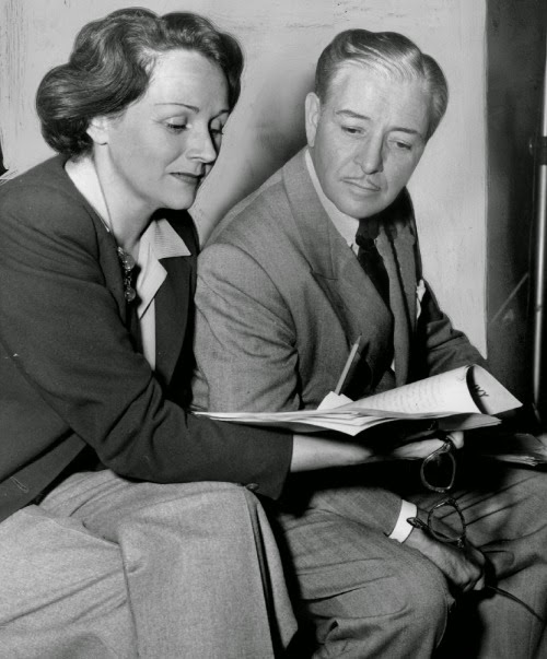 Ronald_and_Benita_Colman_with_an_Ivy_script_circa_1950_