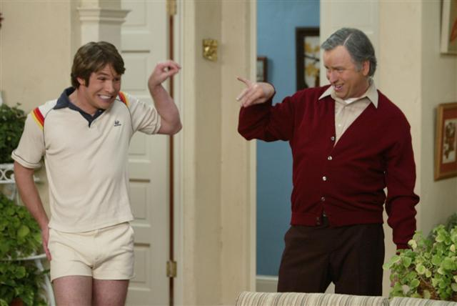 Kyle as Jack Tripper and Paul as Mr. Roper