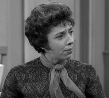 Ann Morgan Guilbert as Millie Helper