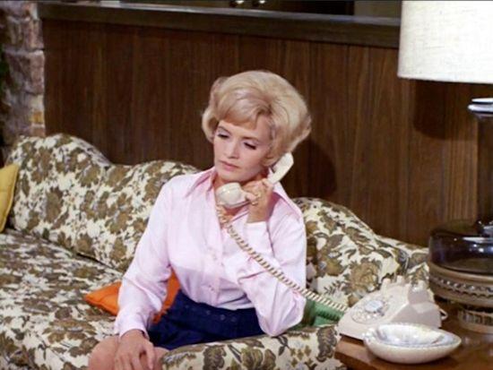 Florence Henderson on The Brady Bunch sofa