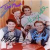 Cast photo autographed by 4